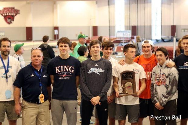 Coach Love stands with his team after winning his first Group A Indoor State Championship (2018)